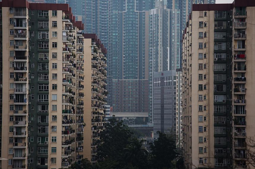 Residential buildings stand in the Mei Foo area of Hong Kong, China, on Feb 3, 2016.
