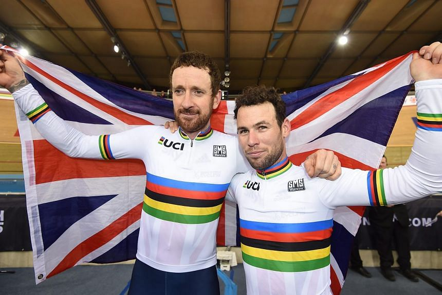 Mark Cavendish and Bradley Wiggins celebrate after winning the Men's Madison final at the 2016 UCI Track Cycling World Championships, in London.