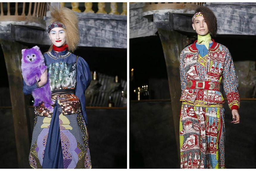 Models present creations - and a purple dog -  by Indian designer Manish Arora during the Paris Fashion Week,