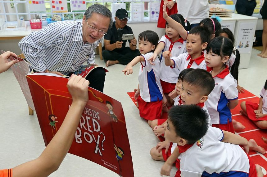 Mr Sam Tan, Minister of State for Manpower and Prime Minister's Office, reading What's Inside The Red Box to K2 pupils at PCF Sparkletots in Radin Mas.