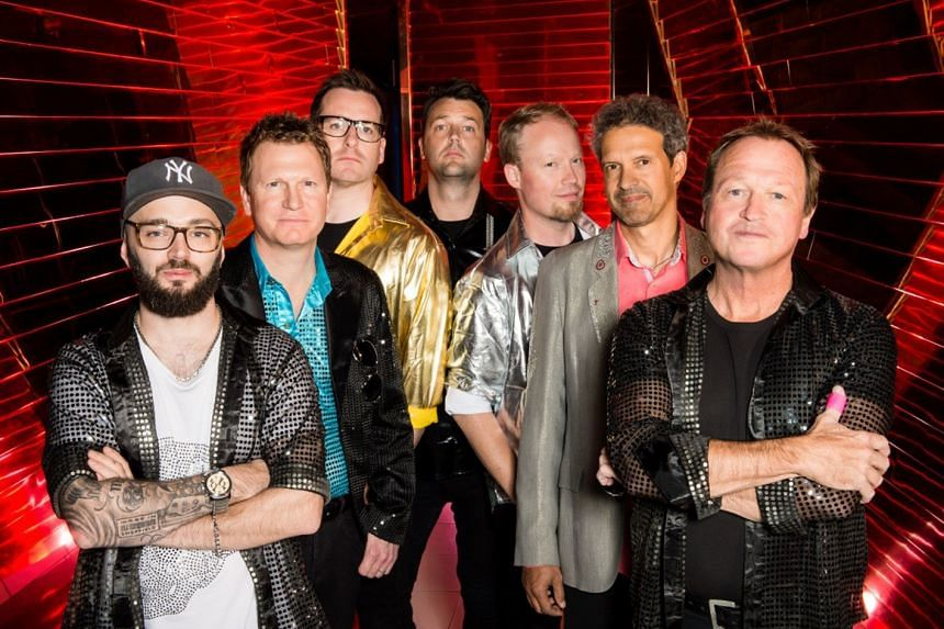 Singer-bassist Mark King (right) with members of Level 42, a jazz-funk band.