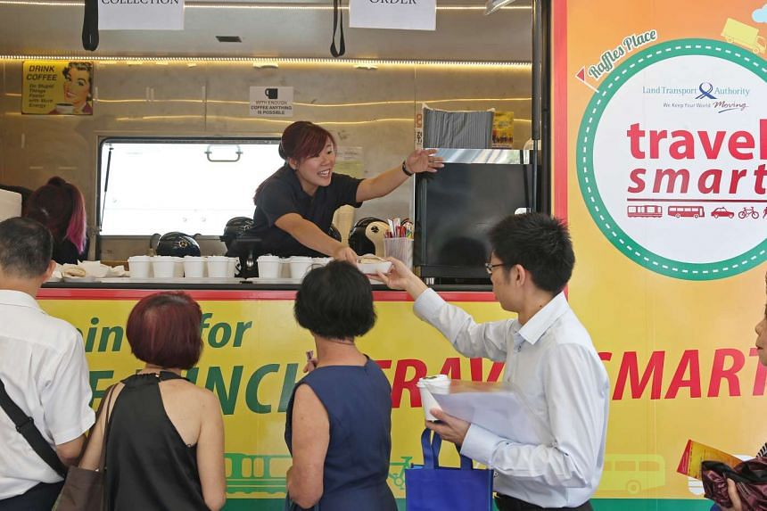 A mobile food truck promoting the Travel Smart Network distributes free lunch outside Raffles Place MRT on March 7, 2016.