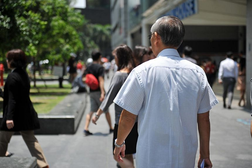 A man walking in the central business district.