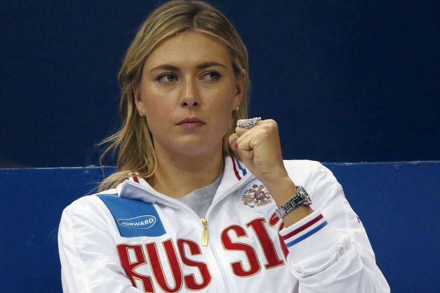 Maria Sharapova reacts as she watches a match between Ekaterina Makarova and Kiki Bertens on Feb 6, 2016.