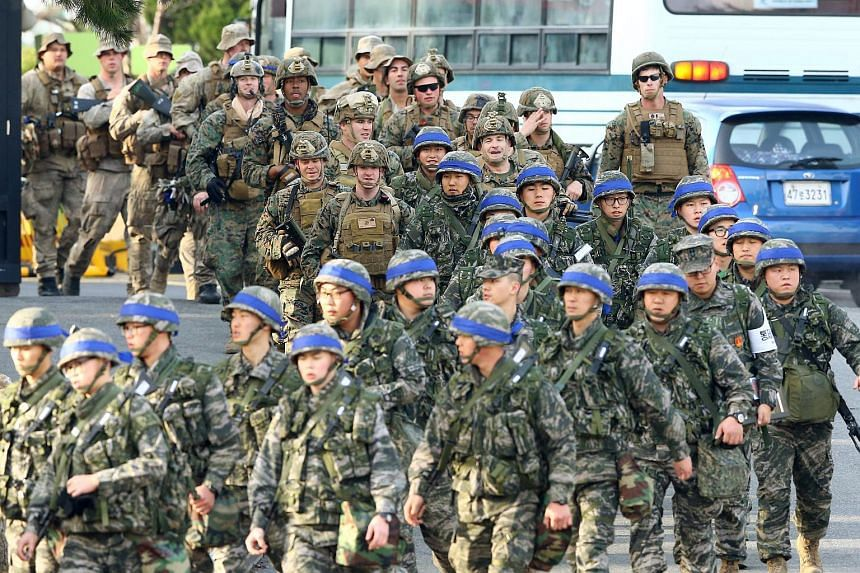 South Korean and US marines leaving a South Korean marine base on March 7, 2016.