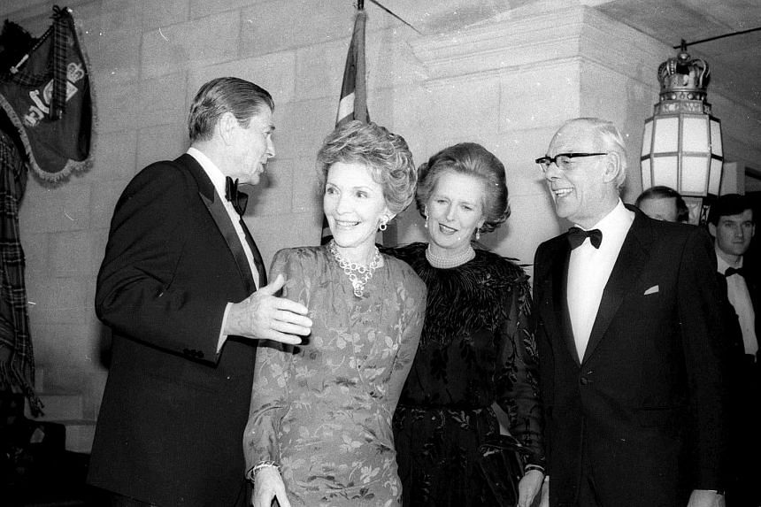 (From left) Then US President Ronald Reagan and First Lady Nancy Reagan escort British Prime Minister Margaret Thatcher and her husband Dennis to the British Embassy in Washington on Feb 20, 1985.