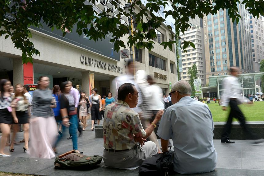 Older office workers chatting at Raffles Place.
