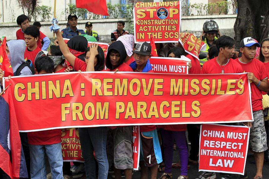 Protesters take part in a protest rally to denounce China's military buildup in the South China Sea in front of the Chinese Consulate in Manila, on Feb 25, 2016.