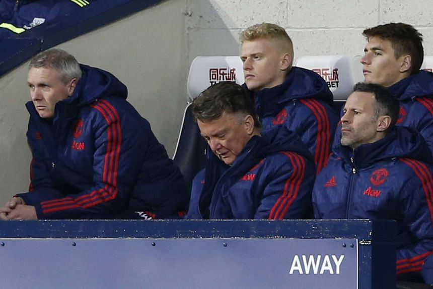 Manchester United manager Louis Van Gaal and assistant manager Ryan Giggs,