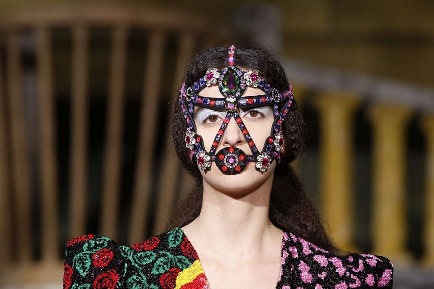 A model presents a creation from the Fall/Winter 2016/17 Ready to Wear Collection by Indian designer Manish Arora during the Paris Fashion Week.