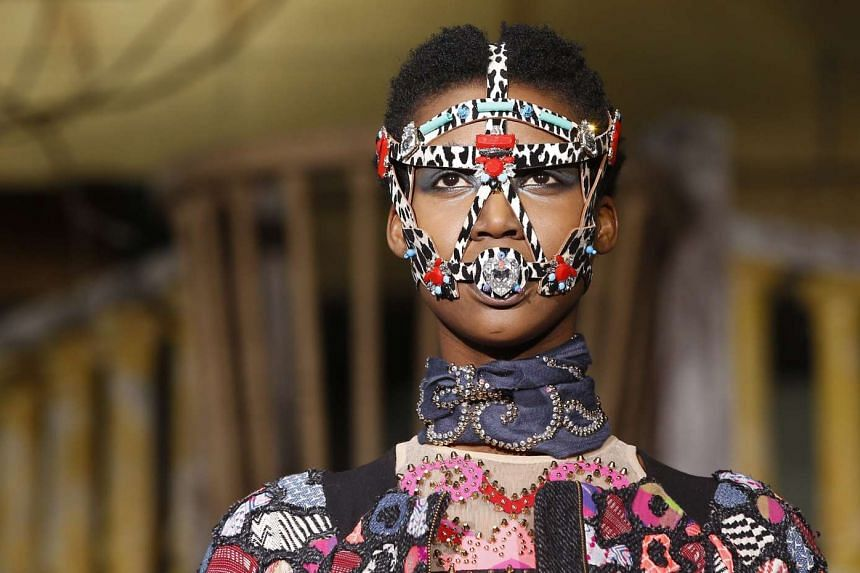 A model presents a creation by Indian designer Manish Arora during Paris Fashion Week.