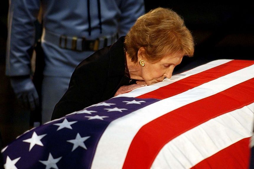 Former US First Lady Nancy Reagan kisses the casket containing the remains of her husband, former US President Ronald Reagan, at the Capitol rotunda in Washington, DC on Jun 11, 2004.