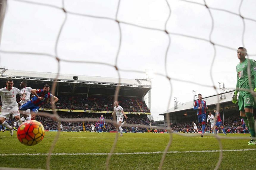 Christian Benteke celebrates after scoring the second goal for Liverpool from the penalty spot.
