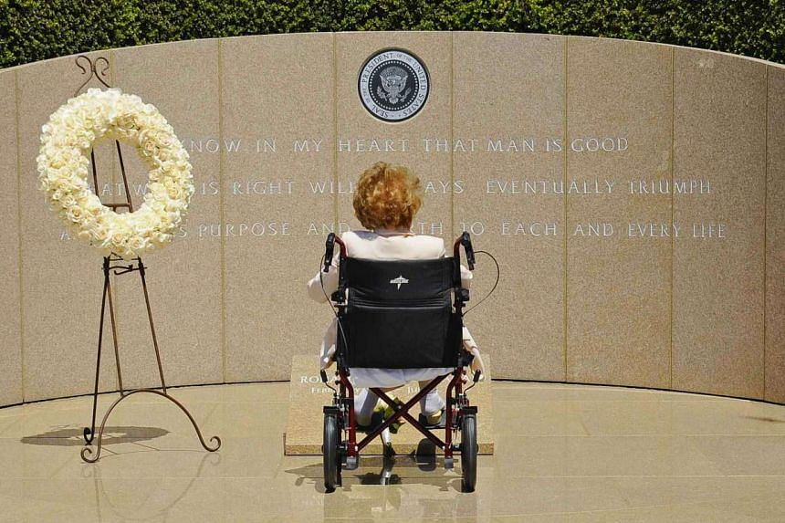 Nancy Reagan visits the grave of her husband at the Ronald Reagan Presidential Library in California on the 10th anniversary of his passing, in a June 5, 2014 file photo.