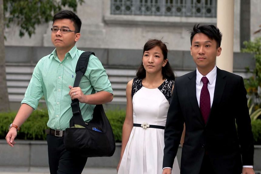 (From left) Yang Kaiheng, Ai Takagi and their lawyer Choo Zheng Xi arriving at the State Courts on March 7, 2016.