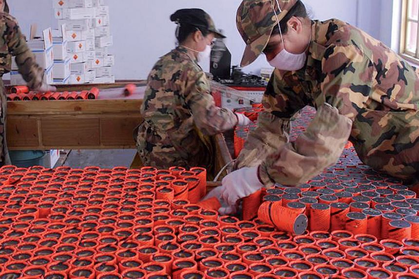 Fabchem China workers assembling explosives at its factory.