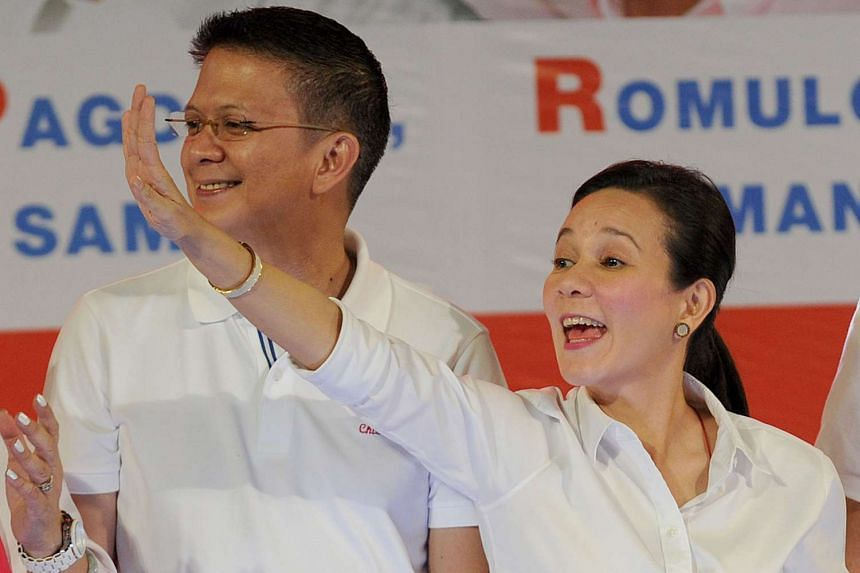 """Philippine presidential candidate Grace Poe (right) next to her running mate Senator Francis """"Chiz"""" Escudero at a rally in Manila on Feb 9, 2016."""
