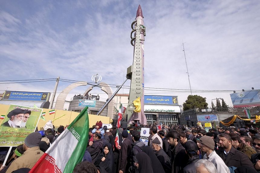An Iranian-made Emad missile is displayed during a ceremony marking the 37th anniversary of the Islamic Revolution, in Teheran on Feb 11, 2016.