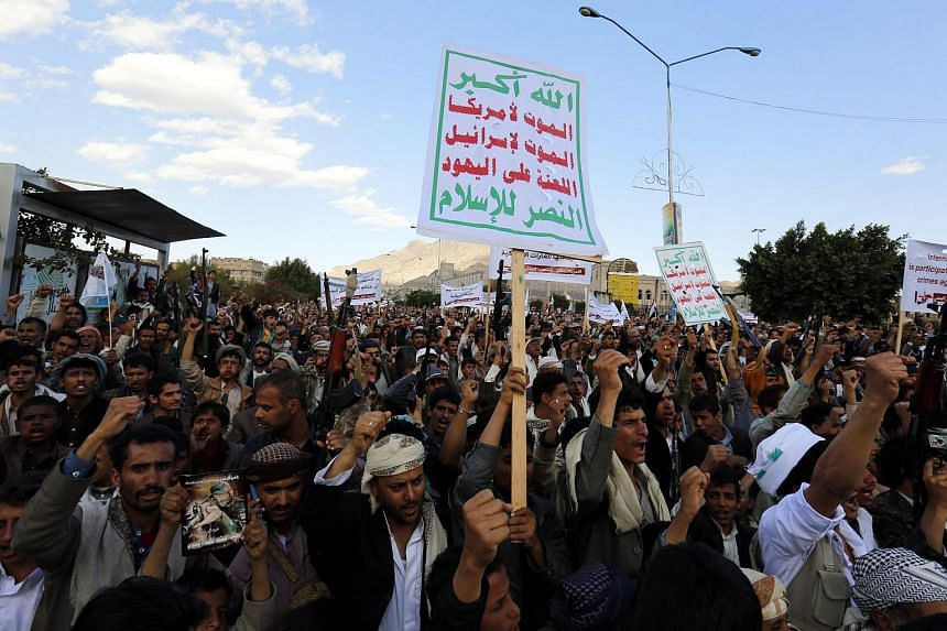 Houthi supporters holding banners during a rally against the US support for the Saudi-led military offensive in Yemen, in the capital Sana'a, on March 1, 2016.