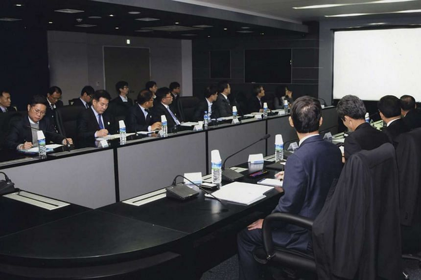A handout picture released by South Korea's National Intelligence Service (NIS) shows representatives of 14 government agencies holding an emergency meeting at the spy agency's building in Seoul, South Korea, on March 8, 2016, to discuss countermeasu