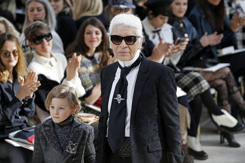 Karl Lagerfeld acknowledges the audience during a fashion show on March 8, 2016.