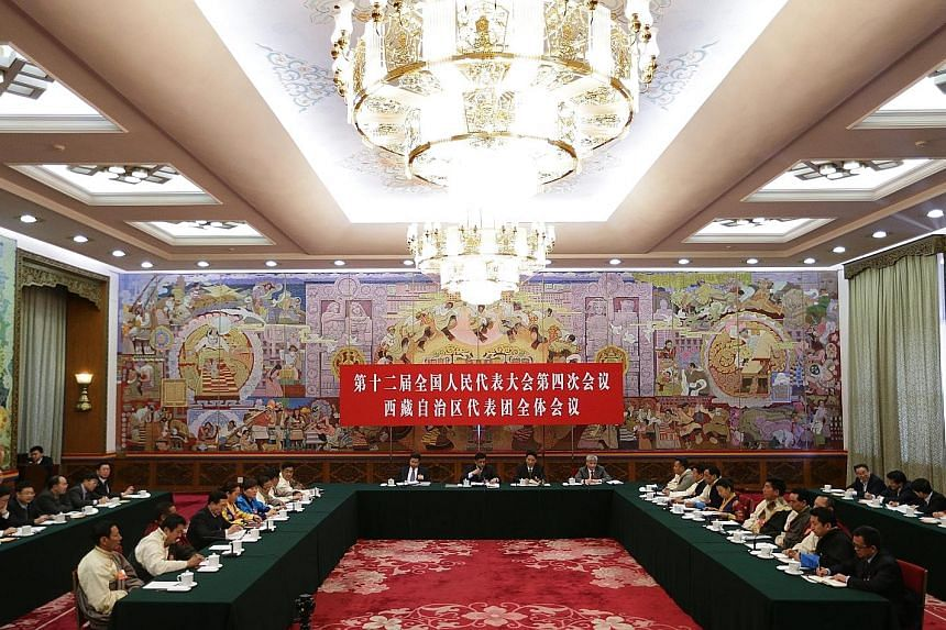 A general view of Tibet Hall during the Tibet delegation meeting on the sidelines of the fourth session of the 12th National People's Congress (NPC) at the Great Hall of the People in Beijing yesterday. The NPC has over 3,000 delegates and is the wor