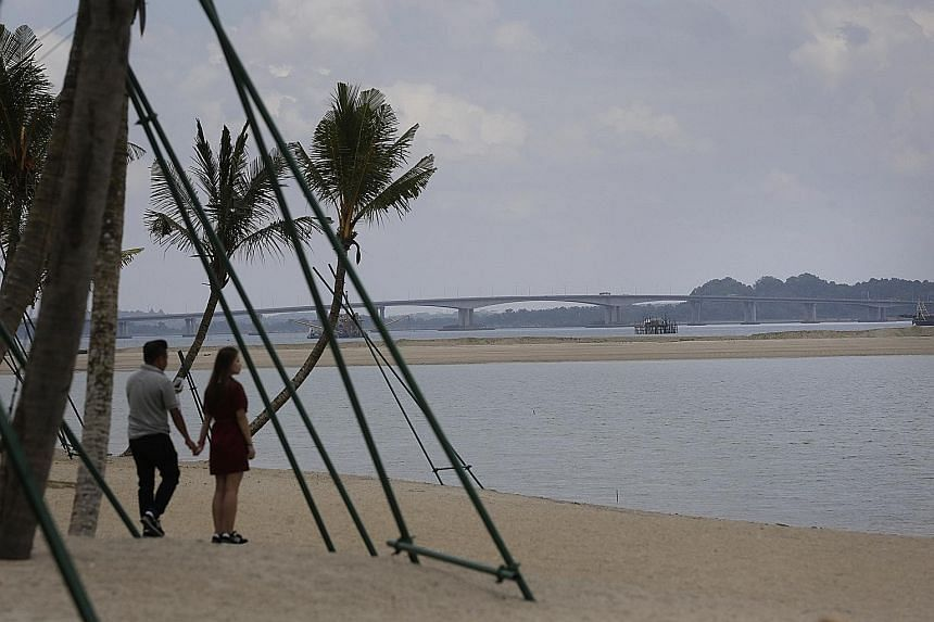 The shore of Forest City, with the Tuas Second Link to Singapore in view. Amid ongoing talks, Country Garden insists it is reclaiming within Malaysian boundaries.