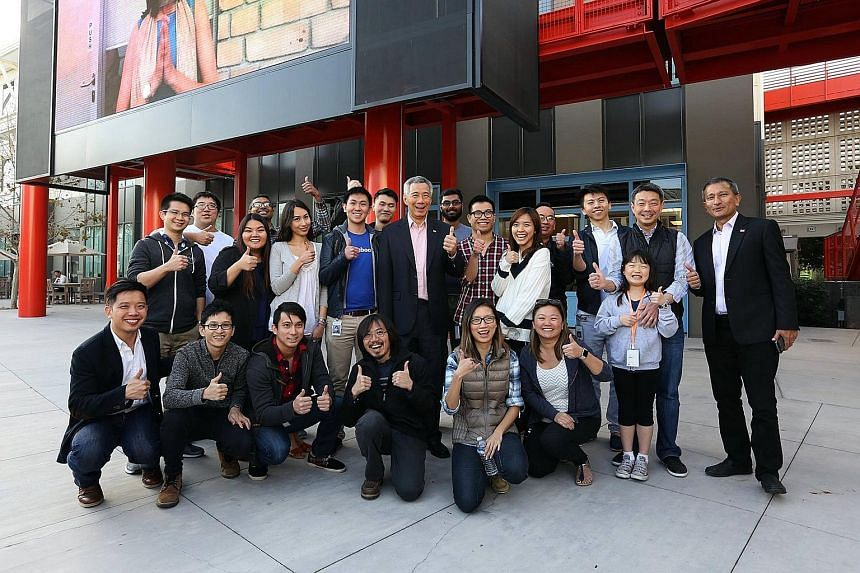 PM Lee Hsien Loong and Foreign Minister Vivian Balakrishnan (far right) with Singaporeans working at Facebook in California last month. PM Lee encouraged Singaporeans working in the US to maintain their links and return one day.