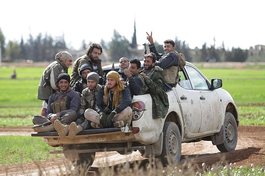 """Rebel fighters in a village in Aleppo, Syria, on Sunday - the """"calmest day"""" in Syria since the ceasefire began on Feb 27, according to the Syrian Observatory for Human Rights."""