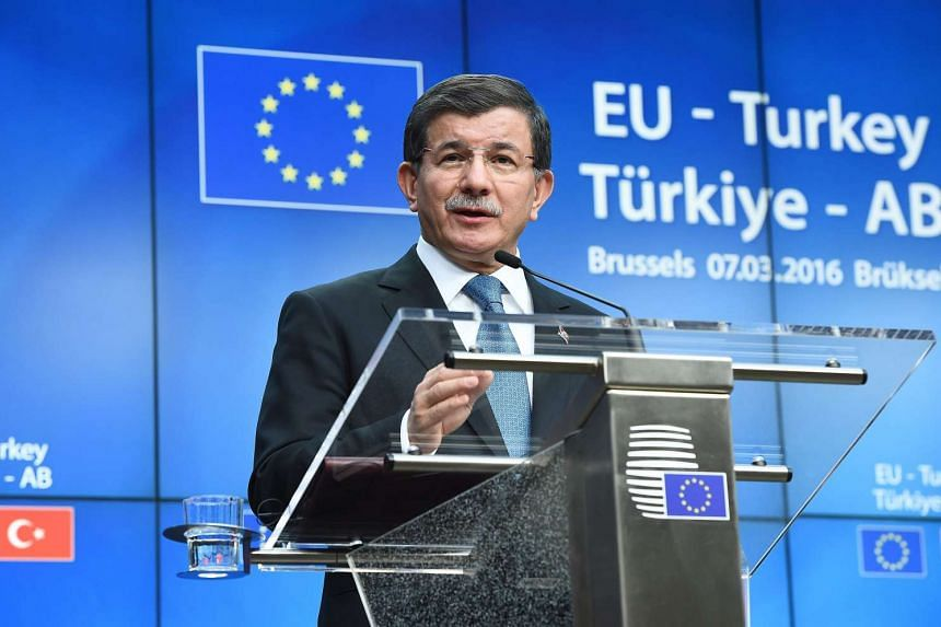 Turkey's Prime Minister Ahmet Davutoglu at a press conference at the end of an EU leaders summit on the migrant crisis, in Brussels, on March 8.