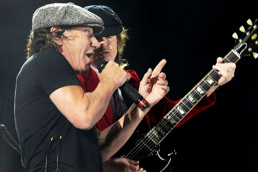 AC/DC's Brian Johnson (left) and Angus Young performing at the Coachella Music Festival in Indio, California, on April 10, 2015.