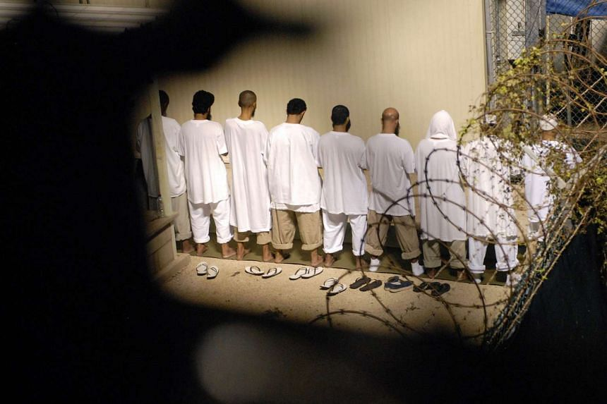 A group of detainees praying inside Camp Delta at Guantanamo Bay on Oct 28, 2009.