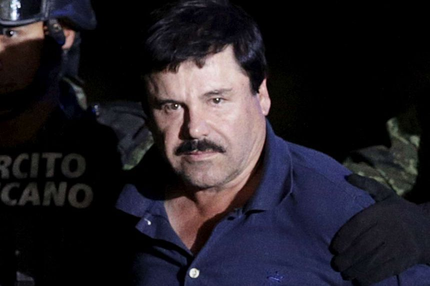 """Recaptured drug lord Joaquin """"El Chapo"""" Guzman being escorted by soldiers in Mexico, on Jan 8, 2016."""