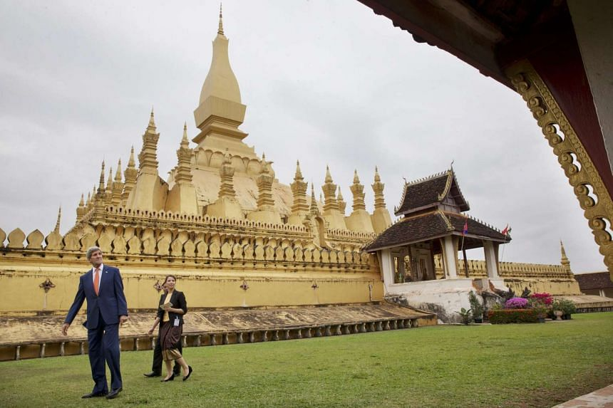 "US Secretary of State John Kerry (left) touring the That Luang Stupa or ""Pha Tha Luang"" in Vientiane, Laos, on Jan 25, 2016."