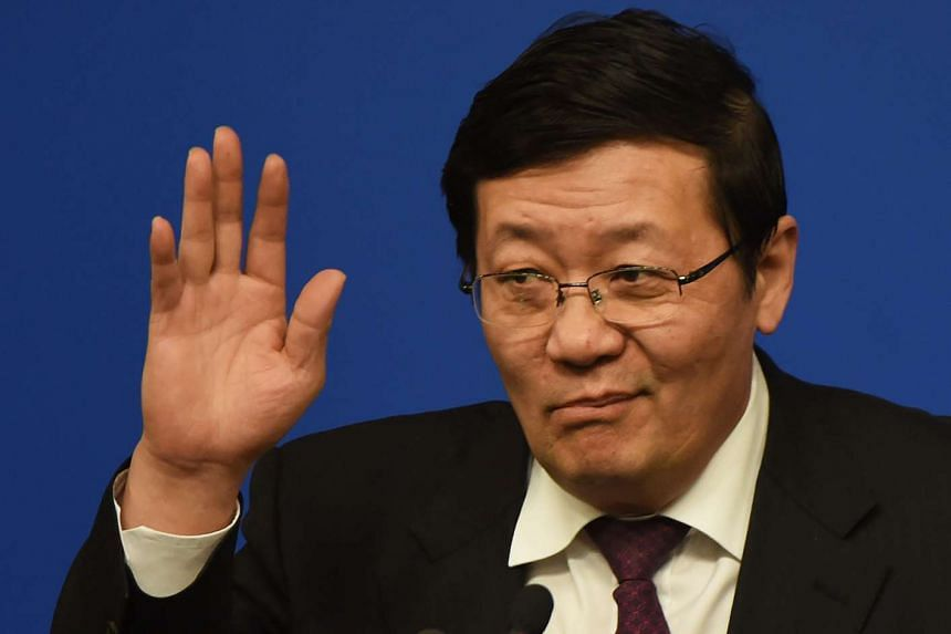 Chinese Finance Minister Lou Jiwei at a National People's Congress press conference in Beijing on March 7.