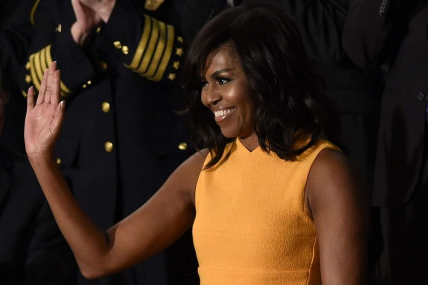 US First Lady Michelle Obama waving before US President Barack Obama's State of the Union Address in Washington, DC, on Jan 12.