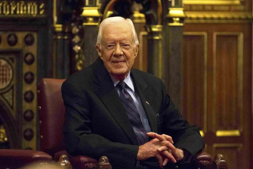 Former US President Jimmy Carter takes a seat after delivering a lecture at the House of Lords in London early last month (Feb 3, 2016).