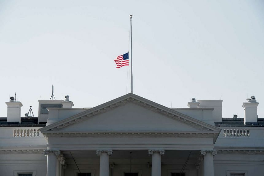 The US flag flies at half-staff atop the White House in Washington, DC, on Monday in honor of former first lady Nancy Reagan who died on Sunday (March 6).