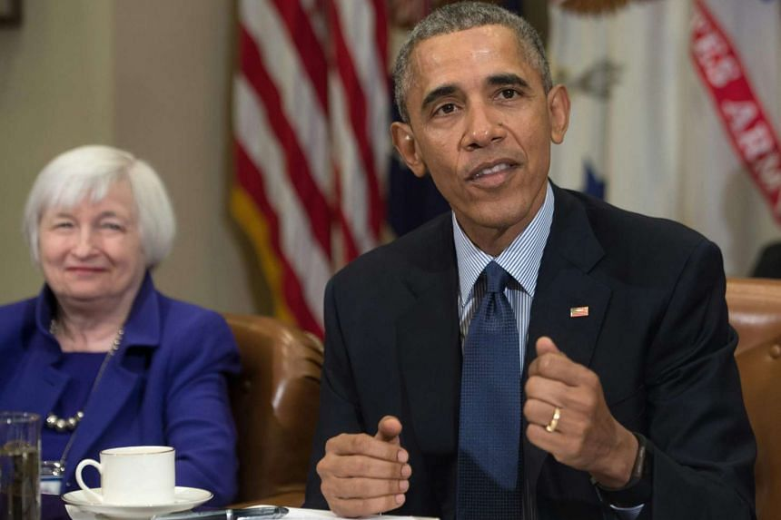 US President Barack Obama speaks following a meeting with financial regulators at the White House on Monday. On his left is Federal Reserve chair Janet Yellen.