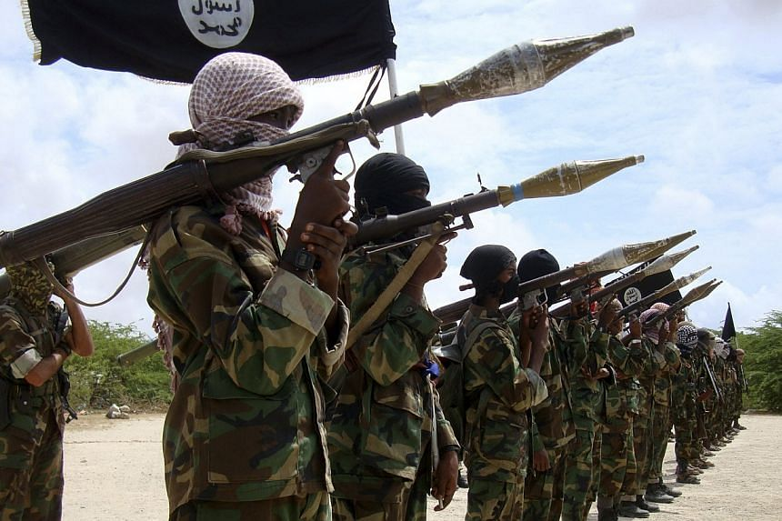 Al Shabaab militants parade new recruits after arriving in Mogadishufrom their training camp south of the capital in this October 21, 2010 photo.