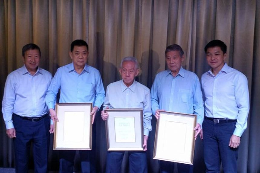 (From left) IOC's Ng Ser Miang, SNOC's Chris Chan, weightlifter Tan Howe Liang, SNOC's Tan Eng Liang, and Minister Tan Chuan-Jin.