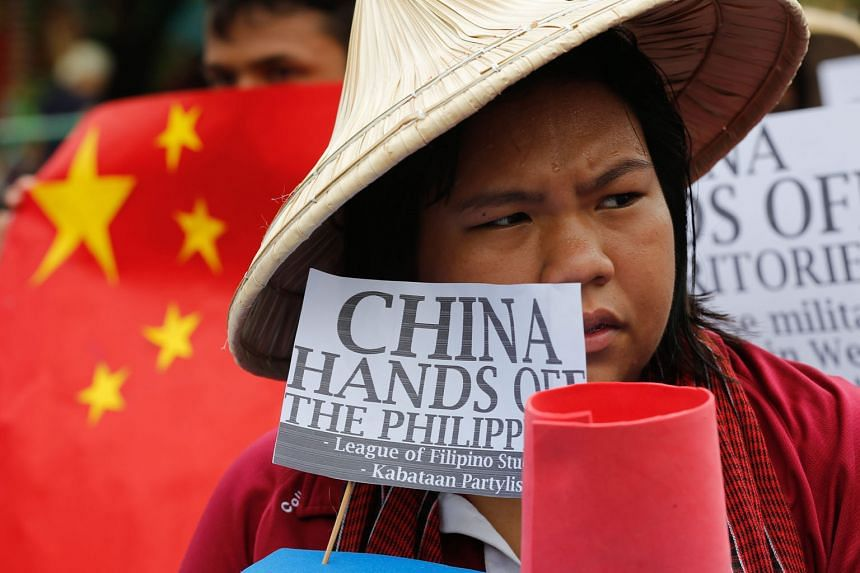 """A Filipino student in Manila protesting against China's actions in the South China Sea. The writer says there is no provision in Unclos on a State's """"right"""" not to participate if a case is instituted against it. PHOTO: EUROPEAN PRESSPHOTO AGENCY"""