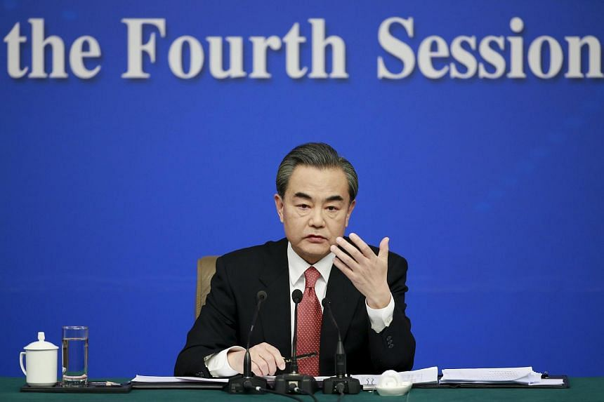 China's Foreign Minister Wang Yi speaks on the sidelines of the National People's Congress, in Beijing, on March 8, 2016.