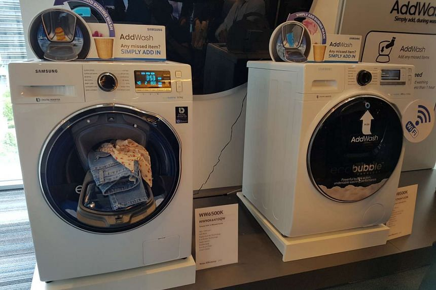 Samsung's AddWash front-loading washing machine with a smaller access door.