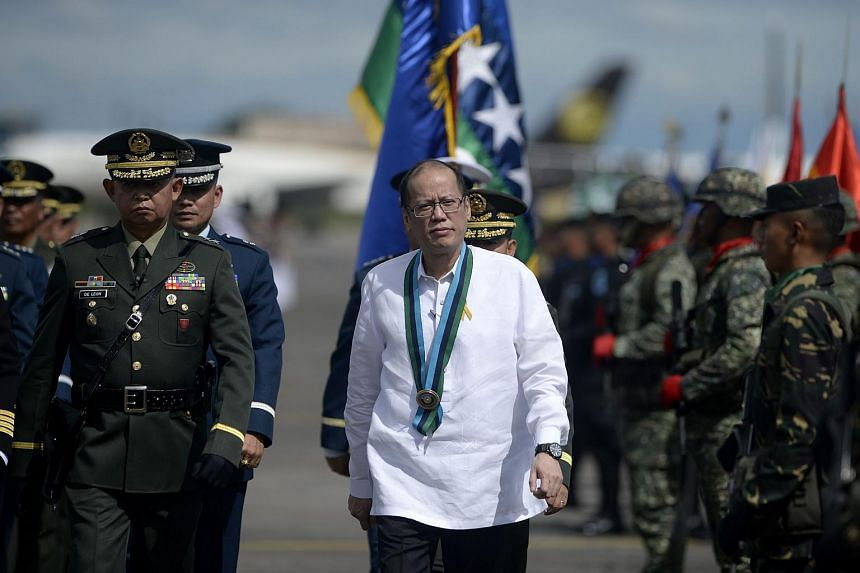 Philippine President Benigno Aquino (centre) has denied that ISIS-liked militants are operating in the Southern Philippines.
