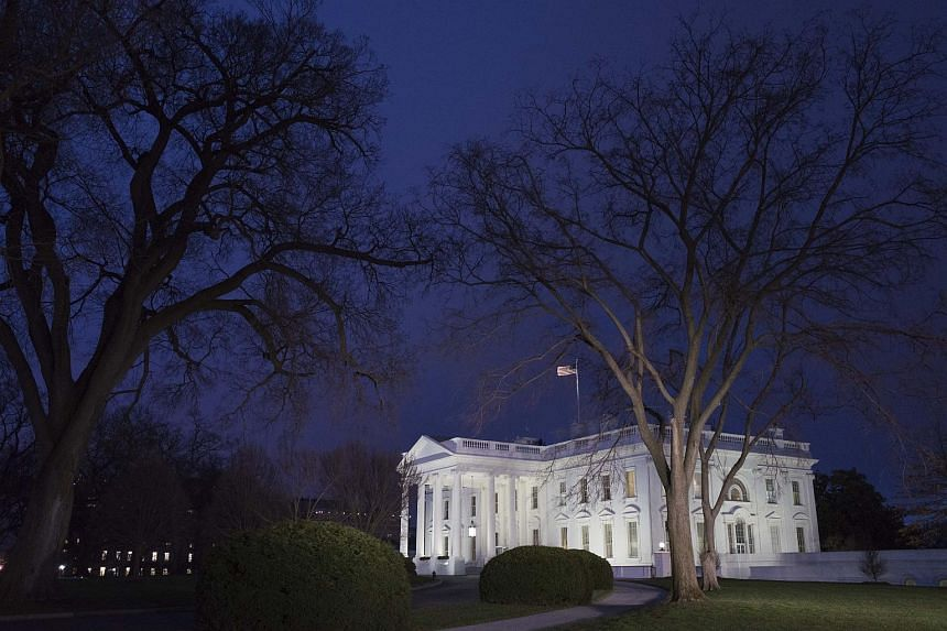 """The man was taken into custody after he threw """"unknown material"""" over the south fence at the White House."""
