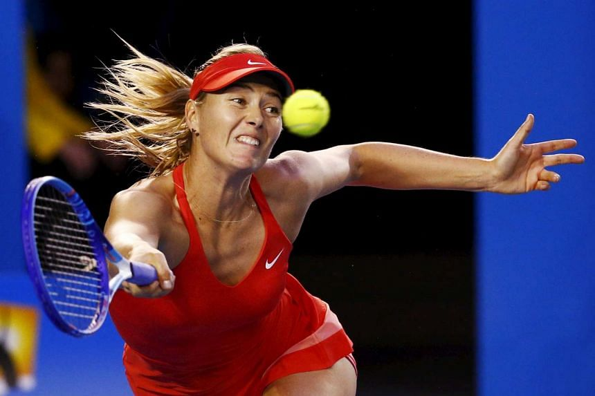 Maria Sharapova of Russia stretches to hit a return to Serena Williams of the US during their women's singles final match at the Australian Open 2015 tennis tournament in Melbourne in this Jan 31, 2015 file photo