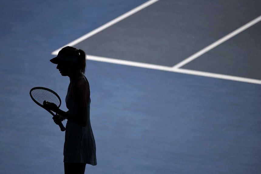 Maria Sharapova of Russia is silhouetted during her second round match against Karin Knapp of Italy at the Australian Open Grand Slam tennis tournament in Melbourne, Australia, on Jan 16, 2014.