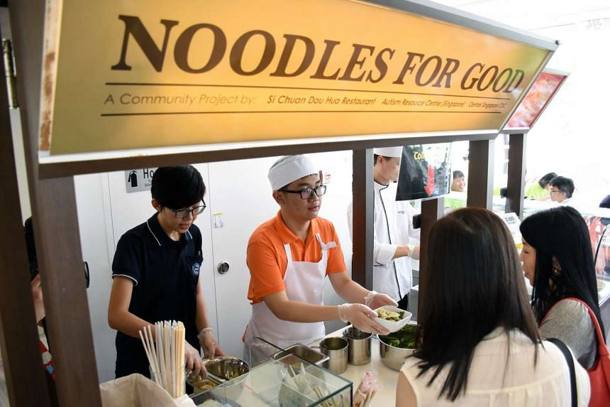 Tan Chun Seng, 19 and his mother Mdm Chan Mee Fong 49 (not in photo), running Noodles For Good, a noodle store at Pathlight School.