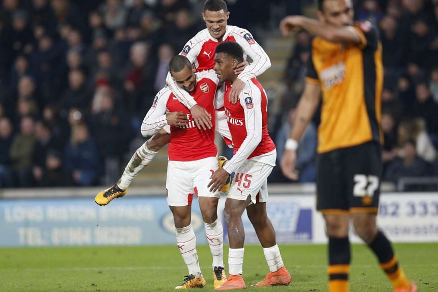 Theo Walcott (left) celebrates with team mates after scoring the third goal for Arsenal.
